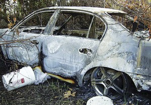 The burnt car in which the remains of Henry Glover were found.