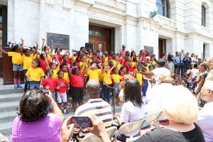 Young members of Tambourine and Fan, shown above, embody the hope and energy of the Civil Rights Movement as they celebrate the Civil Rights Acts 50th Anniversary on the steps of the Louisiana Supreme Courthouse, Wednesday, July 2.  Photo by Dennis Joseph
