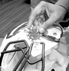 Dr. Gary Harris hopes to improve the way the Howard University Bison football team combats concussion, using this 'Lilypad' Arduino chip to measure impact during games. Photo courtesy Howard University