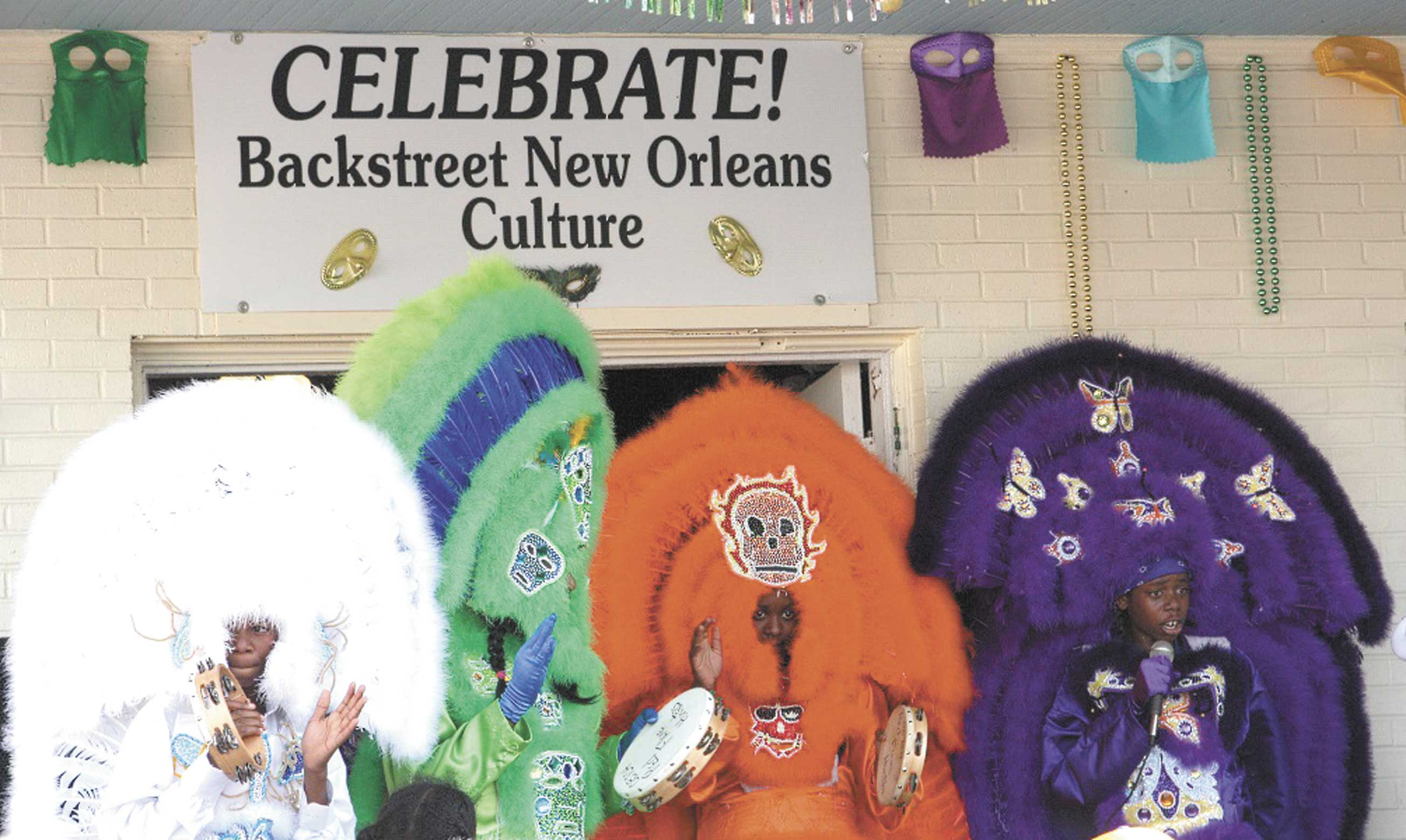 Mardi Gras Indians outside of the Backstreet New Orleans Culture Museum