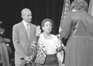 Loretta Lynch being sworn in by Associate Supreme Court Justice Sonia Sotomayor as President Obama looks on.  Freddie Allen/NNPA Photo