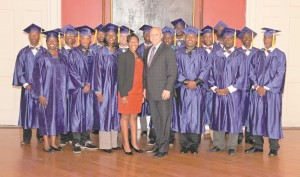 New Orleans Mayor Mitchell J. Landrieu and Ashleigh Gardere, Sr. Advisor to Mayor Mitch Landrieu and executive director of the Network for Economic Opportunity, stand with the 2015 graduates of Strive NOLA, a city-run program designed to hone the skills of disadvantaged residents and ready them to enter the workforce.