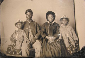 Unidentified African-American soldier in a Union uniform with his wife and two daughters.