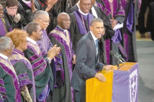 President Obama sings 'Amazing Grace' as the audience and presiding bishops join in.
