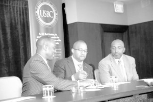 U. S. Black Chambers President/CEO Ron Busby signs Memorandum of Understanding with NAMAD President Damon Lester. Marc Bland, IHS vice president of diversity and inclusion, looks on.