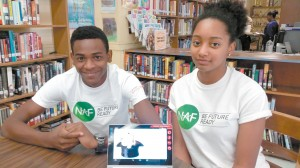 "Warren Easton students, Antoine Philips and Taylor Simien show of their ""Magic Hat"" App they created as participants in the Lenovo Scholars Network."