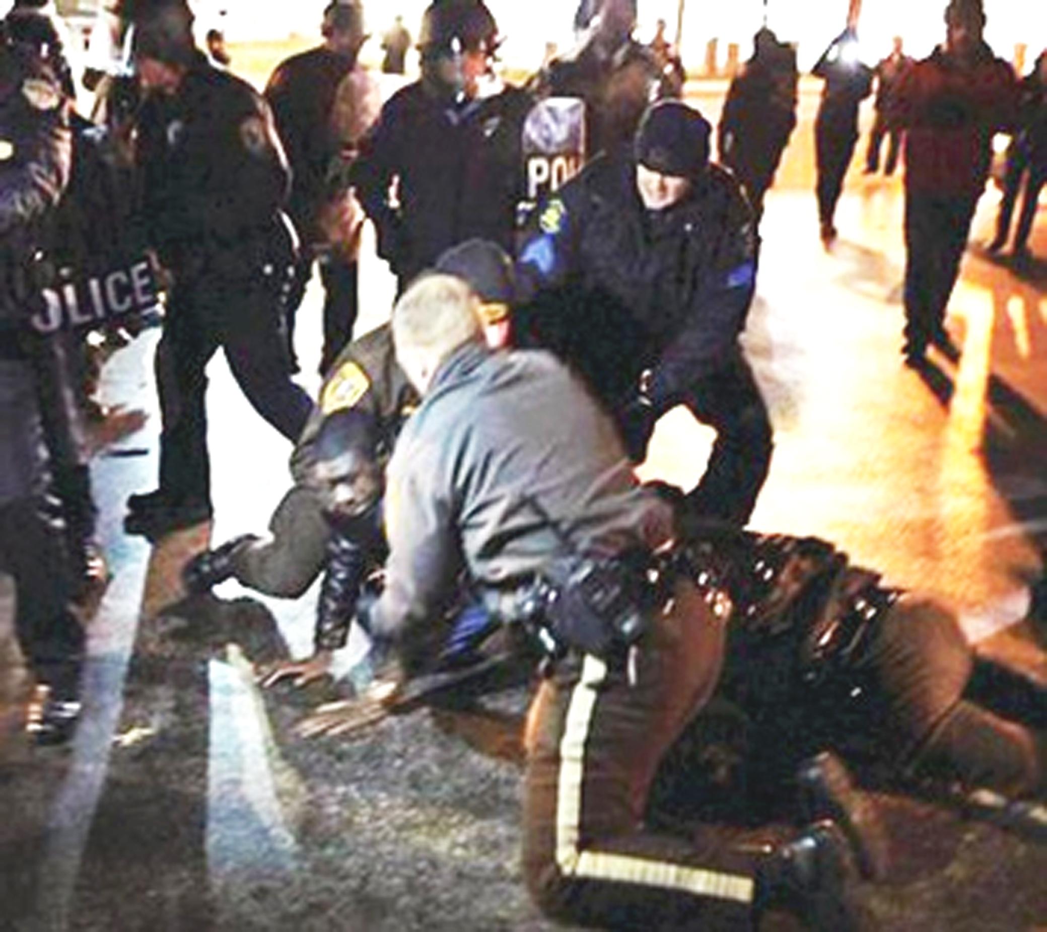Police arresting protesters in Ferguson, Missouri, Nov. 20, 2014