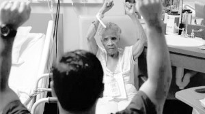 Willie Mae Rich exercises with nurse Andres Viles, who keeps elderly patients mentally and physically active at Birmingham hospital.