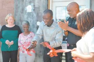 Owner Burnell Cotlon, center, opens the Lower Ninth Ward Laundromat at a ribbion cutting on Sept. 15 with his mother Lillie Mae Cotlon, second left; Councilman James Gray II, second from right; and Cotlon's wife, Keisha, at right.