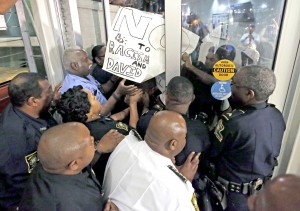Police keep protesters from pushing through an auditorium door on Dillard University\u0027s c&us which hosted a & Dillard students react to David Duke on HBCU campus | New Orleans ...