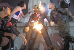 Protesters burn an effigy of Donald Trump in Lee Circle before a march through New Orleans, La, November 9, 2016.