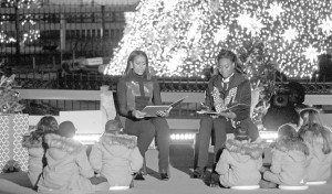 First Lady Michelle and Olympic swimmer Simone Manuel read stories to children after the lighting of the National Christmas Tree.