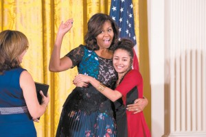 Michelle Obama hugs Noemi Negron at the National Arts and Humanities Youth Program Awards ceremony at the White House.