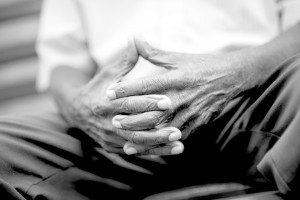 Elderly-man-clasping-hands-