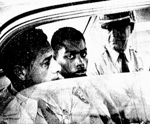 In this February 1964 photo, Henry Montgomery, flanked by two deputies, awaits the verdict in his trial for the murder of Deputy Sheriff Charles H. Hurt in Louisiana. Montgomery, a 71-year-old prisoner who was 17 when he killed a sheriff's deputy, learned Wednesday, June 21, 2017, that he would get a chance at parole, 54 years after the killing and a year after winning his appeal before the U.S. Supreme Court.